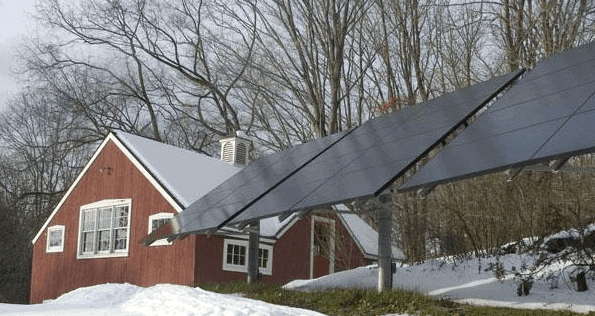 solar panels outside of a home during winter