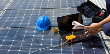 health and safety inspectors looking at solar panels