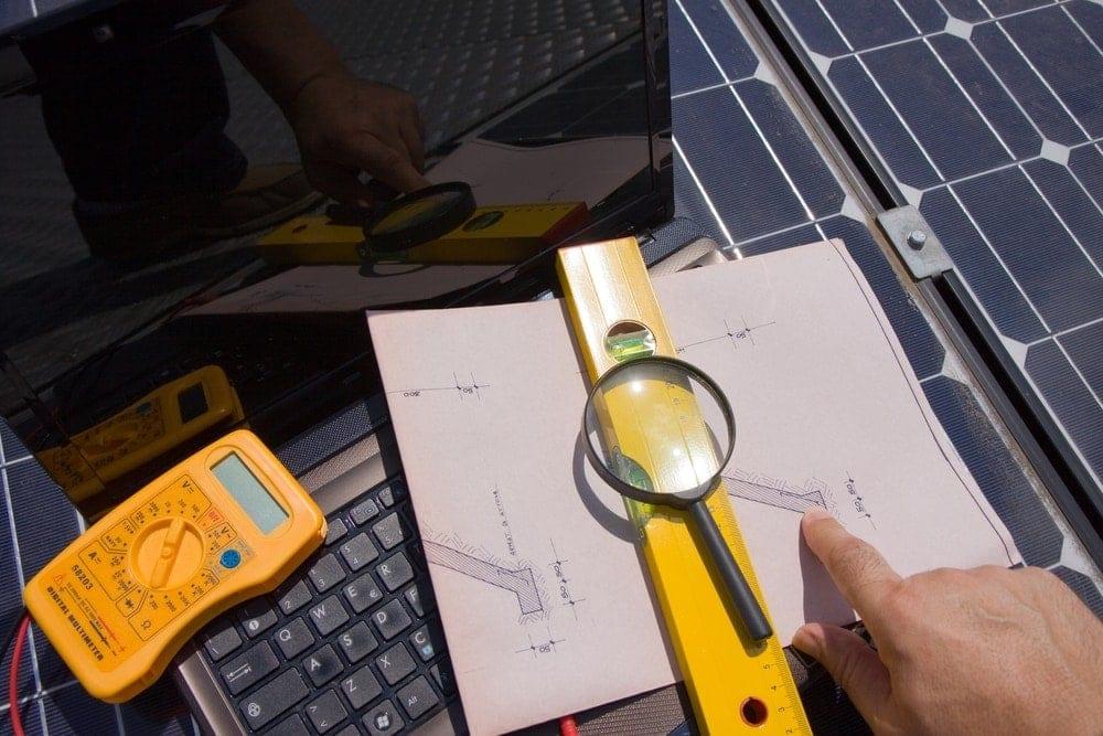 man testing solar panels