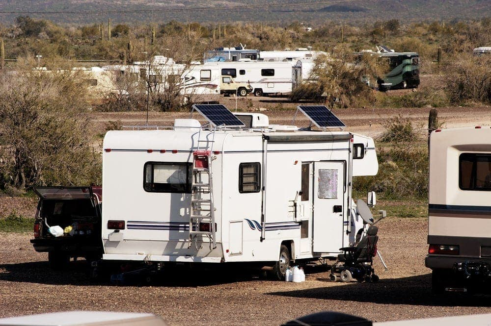rv with two solar panels on its roof