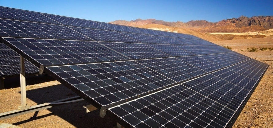 solar panels in the middle of the hot desert