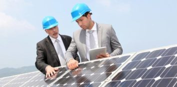 two engineers checking solar panels