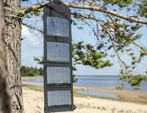 portable solar panel hanging from a tree