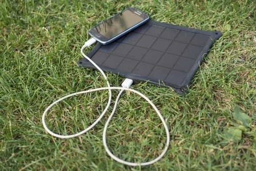 solar panel charging an iphone