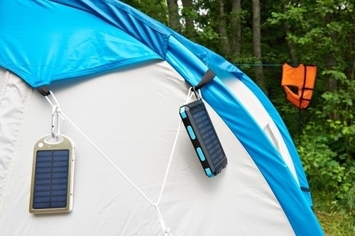 two small portable solar panels hanging from a tent