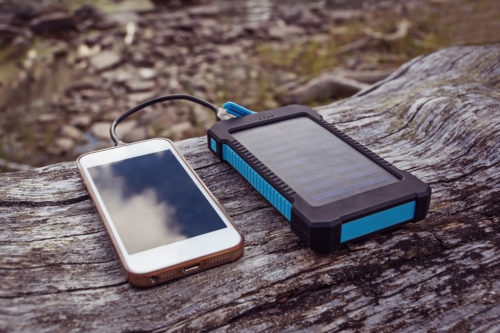 phone being charged by a solar power bank