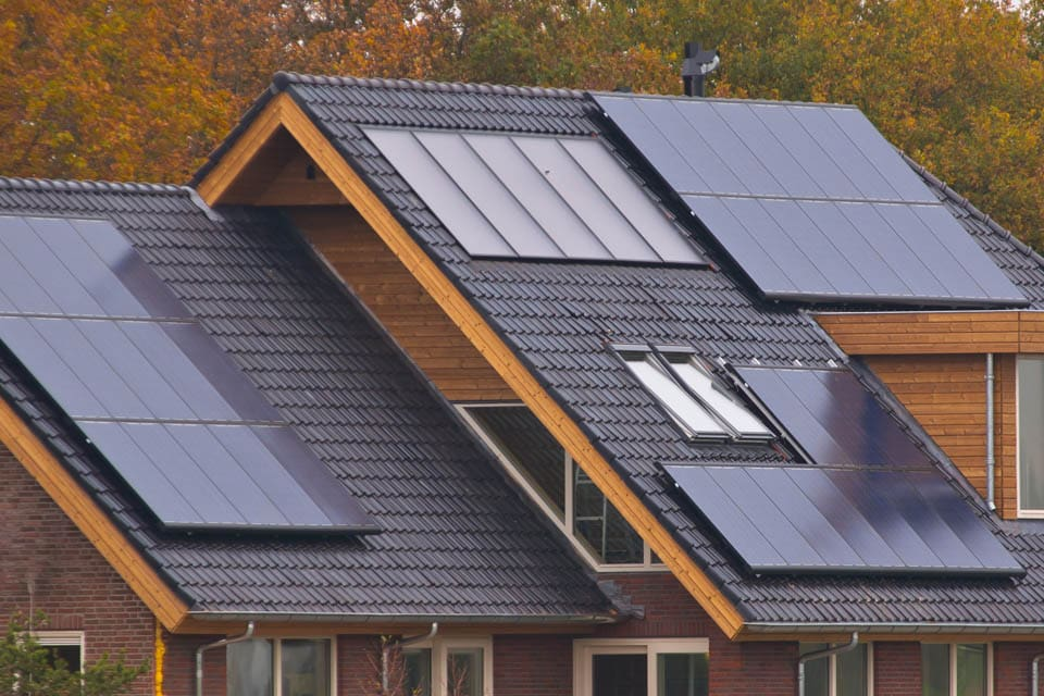 home with solar panels installed on two roofs
