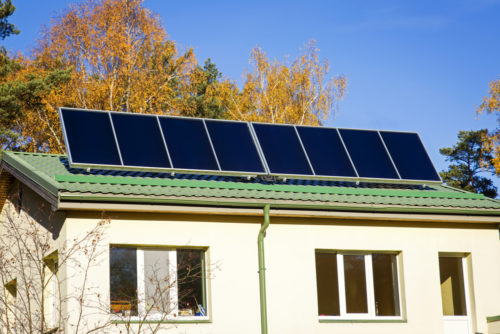 A solar panel system installed on the roof of a small home