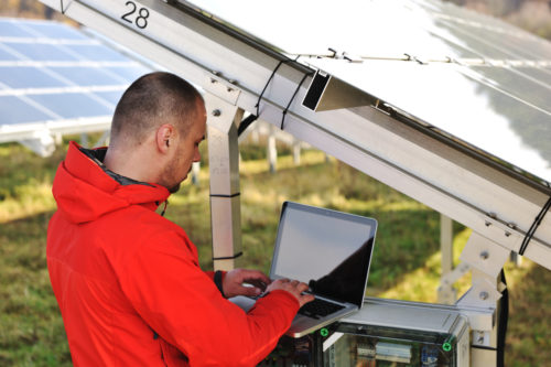 Technician checking the performance of a solar panel