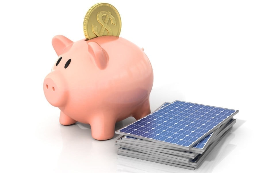 piggy bank next to a pile of solar panels