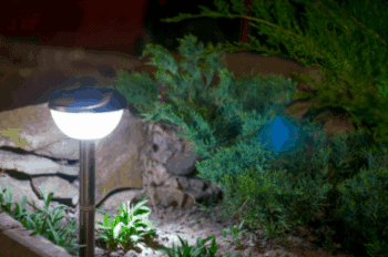 solar powered garden light pushed into the ground