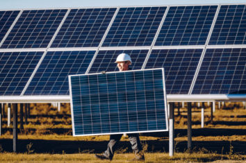 Man carrying a solar panel