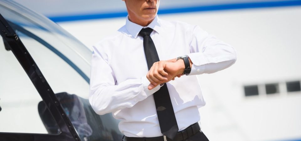 A business man checking his solar watch