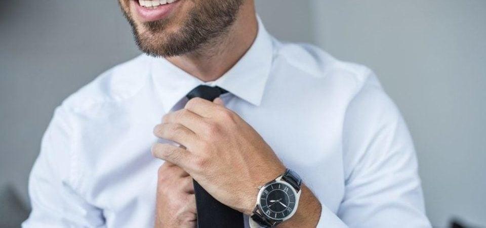 A business man wearing a clean smart solar watch