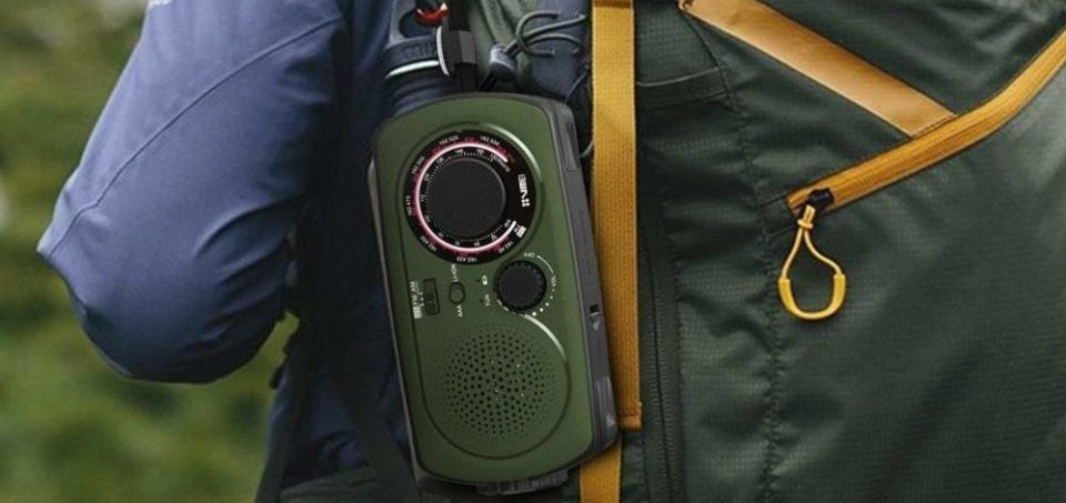 VMEI NOAA Weather Radio connected to a camping rucksack