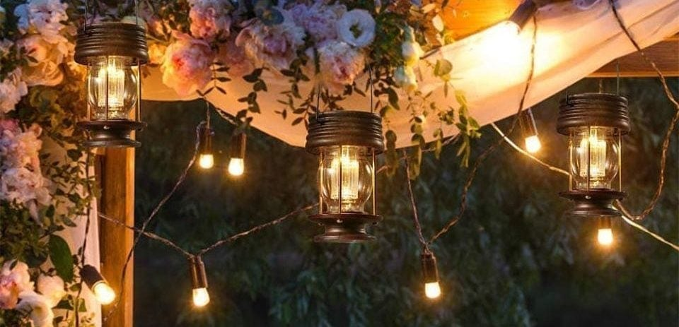 outdoor solar lanterns hung on wood