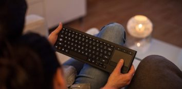 a couple using a keyboard in their living room