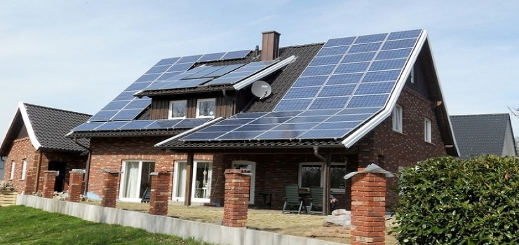 a house with multiple solar panels installed on the roof