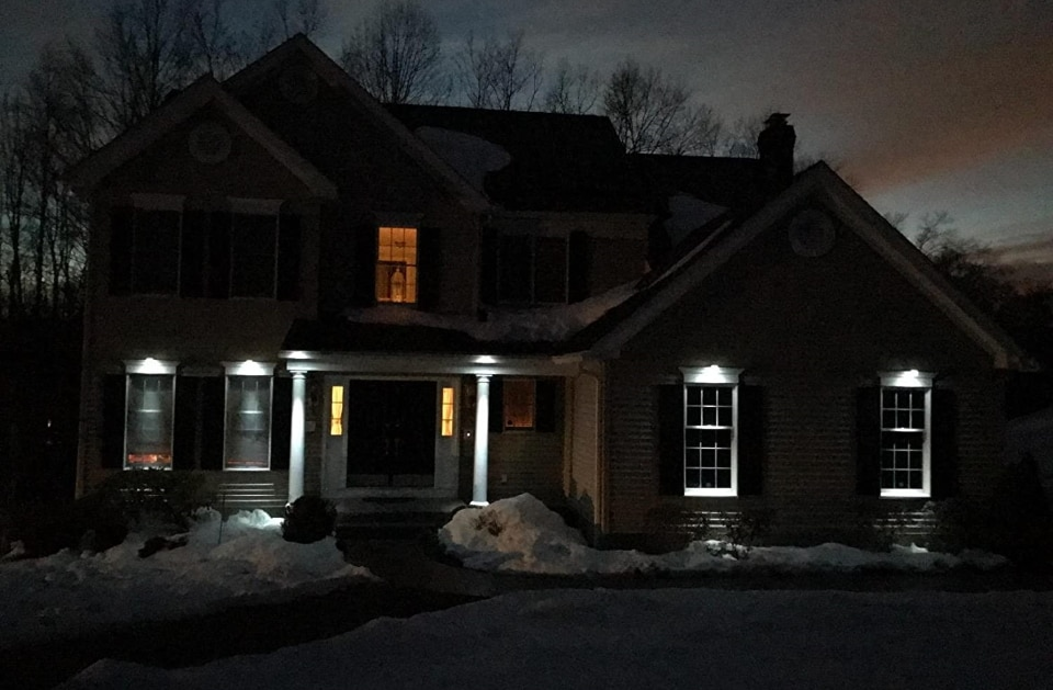 a house with solar gutter lights