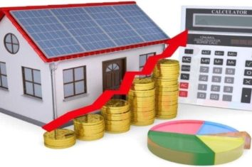a house with solar panels and a calculator with money