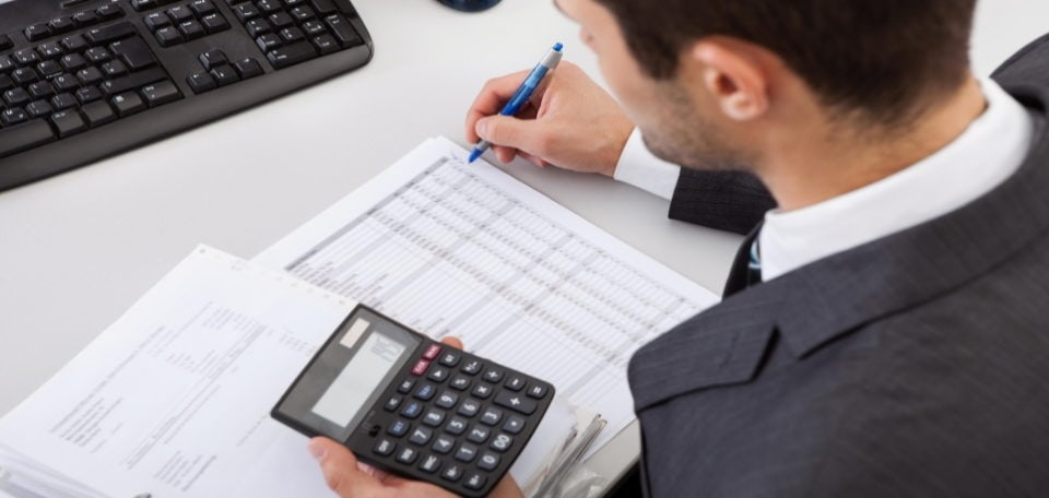 a man accounting for his taxes