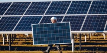 a man carrying a solar panel