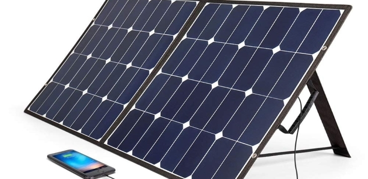 a portable solar panel charging a mobile phone