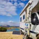 a portable solar panel next to a camper van