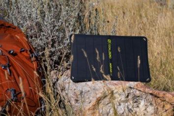 a portable solar panel on a rock