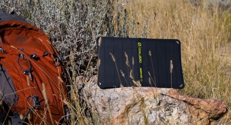 a portable solar panel on a rock