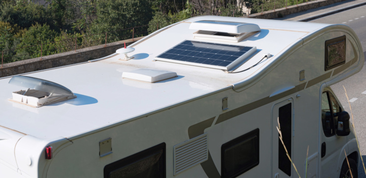 a portable solar panel on the roof of a mobile home