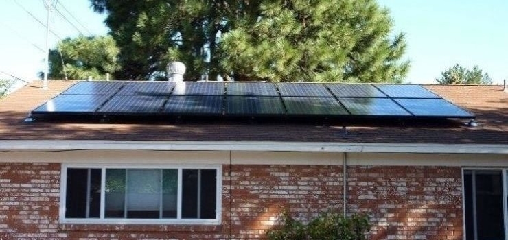 a set of solar panels installed on the roof of a house