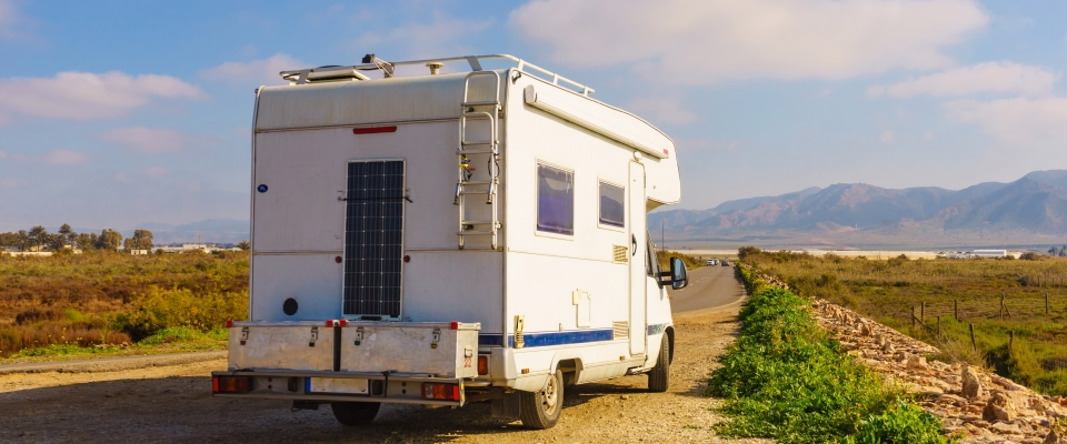 a solar panel on the back of a camper van