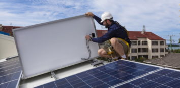 a technician disconnecting a solar panel