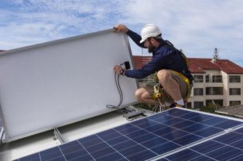 a technician disconnecting a solar panel