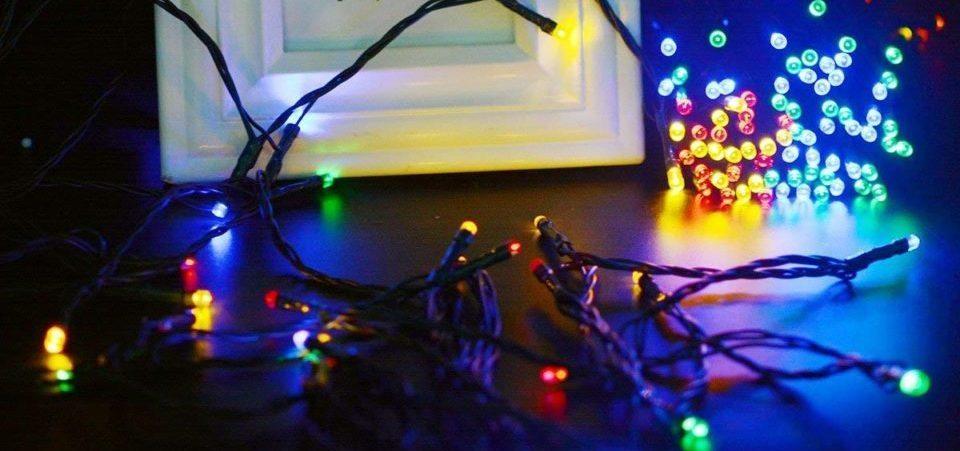 christmas string solar lights around a photo frame