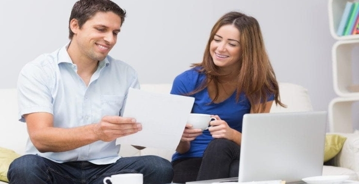 couple checking their electricity bills