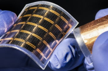 Someone with gloves holding an ultra thin-solar cell