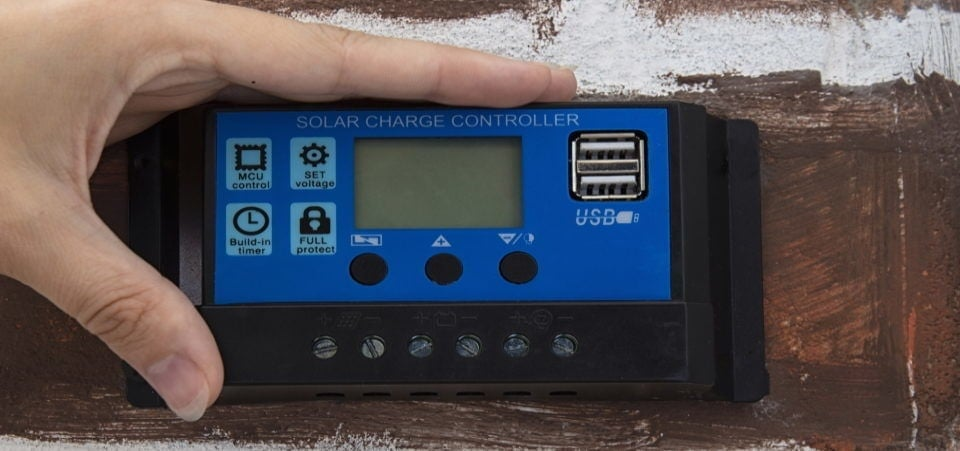 hand on solar charge controller