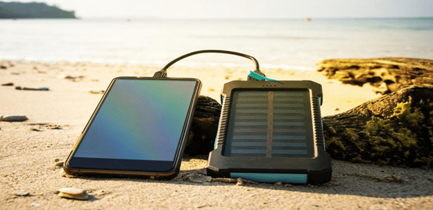image showing a solar battery charger connected to a mobile phone