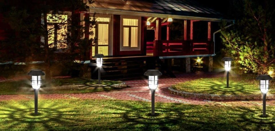 outdoor solar lights on the grass of the house