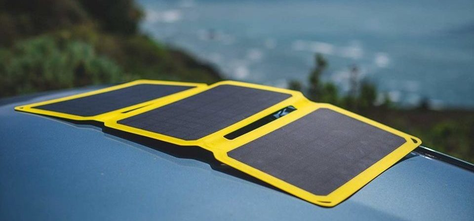 portable solar charger on top of a car