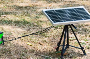 portable solar panel outdoors charging a lamp