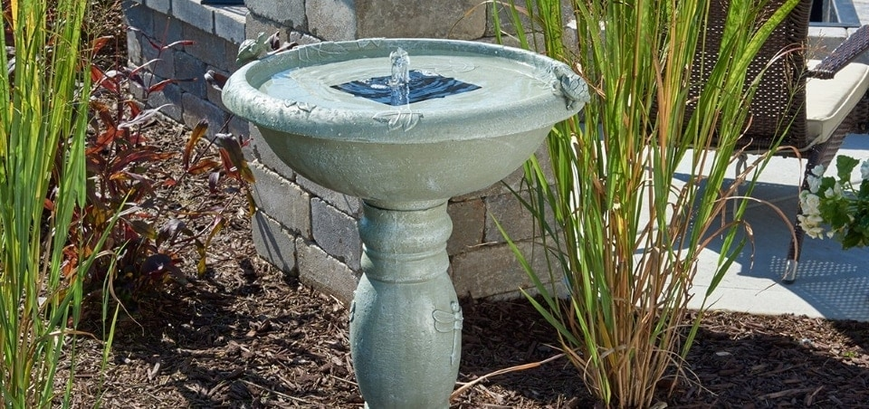 solar birdbath fountain is close the chair