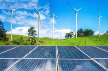 solar panel and wind turbines farm on green hills