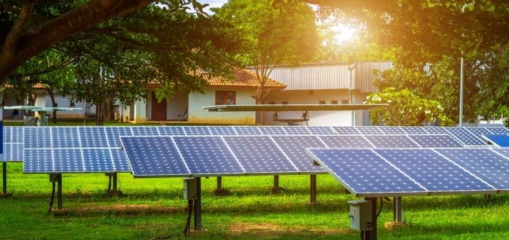 Multiple solar panels outside under the sun