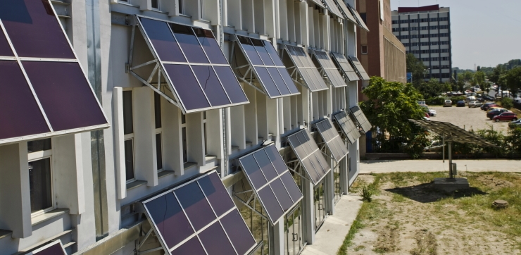 solar panels on the windows of each building