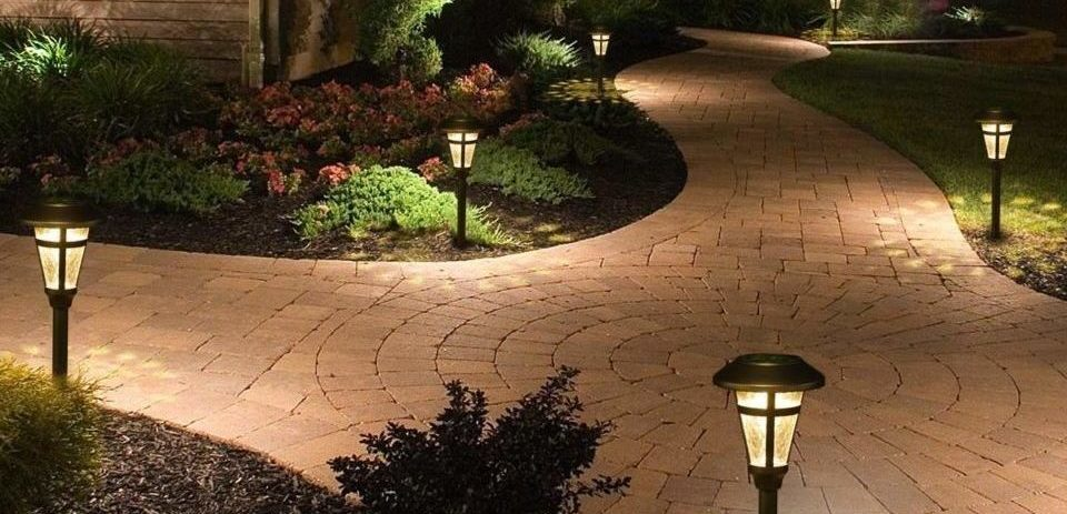 solar path lights outside the house over the garden