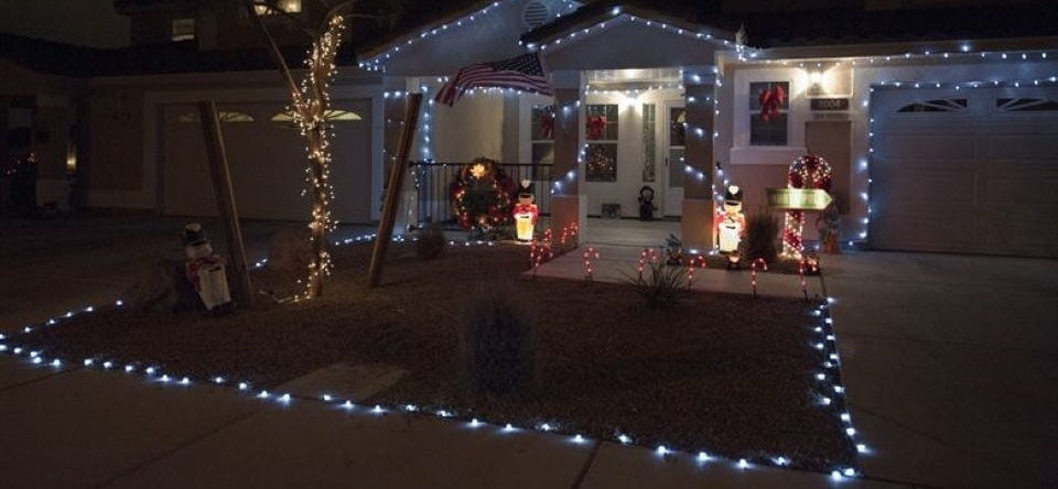 the house decorated with Christmas lights