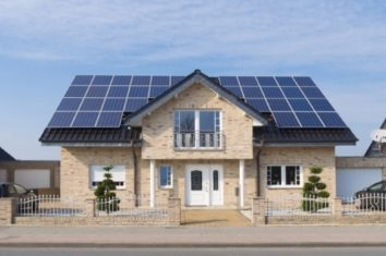 A small house that has solar panels on the roof